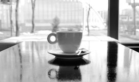 Lonely coffe cup. Coffe cup on a black cafe table Royalty Free Stock Images