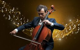 Lonely composer playing on cello royalty free stock image