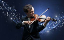 Lonely composer playing on violin royalty free stock photography