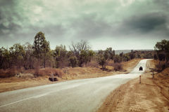 Lonely Country Road with Instagram Effect. A lonely country road with one vehicle, in outback Western Australia, with an instagram effect royalty free stock photo