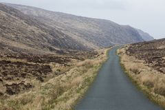 An isolated country road in the hills of Donegal in Ireland. This lonely country road runs through the Derryveagh Mountains in the wilds of Donegal, Ireland stock photos
