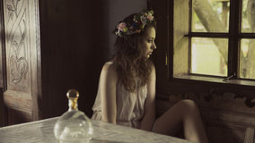 Lonely cute woman in old interior royalty free stock images