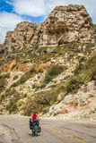 Lonely cyclist cycling on the Ruta 40 Stock Photo