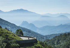 Lonely cyclist in the mountains. Lonely cyclist in the French Pyrenees royalty free stock image
