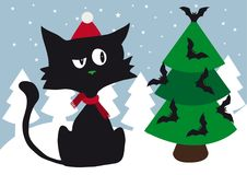 Lonely cynical black cat with red scarf and red santa cap celebrating Christmas using halloween scary bats. Like Christmas tree decoration Stock Image