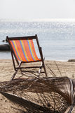Lonely deckchair on the beach Royalty Free Stock Image
