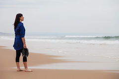 Lonely and depressed woman watching the sea Royalty Free Stock Photos