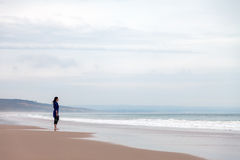 Lonely and depressed woman watching the sea Stock Photography