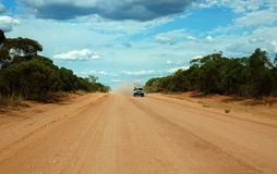 Lonely desert outback road, Australia Royalty Free Stock Photos