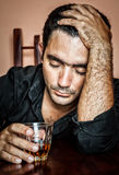 Lonely and desperate drunk hispanic man Stock Images