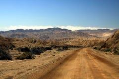 Lonely dirt road into barren dry valley in Atacama desert, Chile stock image