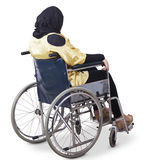 Lonely disabled woman sitting on wheelchair Stock Images