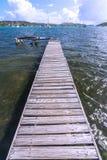 Lonely dock. Long plank wood dock extends into quiet bay of Ensenada Honda on the Caribbean island of Isla Culebra in Puerto Rico Stock Photo