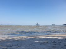 Lonely dream beach at thailand koh yao noi by low tide ebb and flow. Lonely dream beach at thailand koh yao noi ebb and flow at low tide stock photos