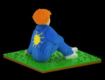 Lonely dreamer - 3d voxel art. Red head boy or girl wearing jeans costume with a cartoonish sun painted on the back of the jacket sits in the grass, dreaming Royalty Free Stock Image