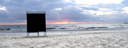 Lonely dressing booth. Dark drassing booth on a sandy beach at sunset Stock Photography