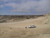 Lonely driver in the desert Stock Photo