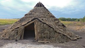 Lonely dugout. A re-created house of ancient people made of land somewhere in russia stock photo