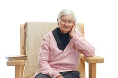 Lonely elderly woman Stock Images
