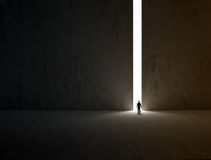 Lonely explorer. A lonely person walking through a narrow passage Royalty Free Stock Image