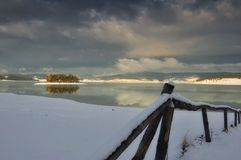 The Lonely fence and the lake. The one of the most beautiful lakes in Bulgaria - Batak Stock Photo