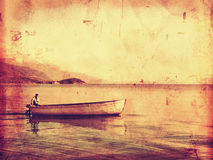 Lonely ferryman. On boat vintage style Royalty Free Stock Photography