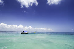 Lonely fiber boat anchored at sunny day Royalty Free Stock Photos