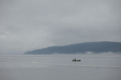 Lonely fisher boat. In remote setting on a lake in British Columbia, Canada Stock Photo