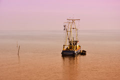 Lonely fisher boat Royalty Free Stock Photos