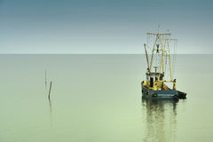 Lonely fisher boat Royalty Free Stock Photo