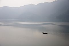 Lonely fisherman in the boat Stock Photography