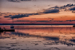 Lonely fisherman. The decline on an outcome of summer aggravates perception of beauty of the nature Stock Photography