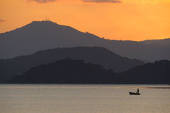 Lonely fisherman in the Nicoya Gulf after sunset. Stock Images