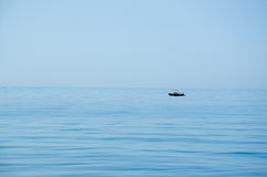 Lonely fisherman Stock Images