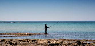 Lonely fisherman Stock Photography