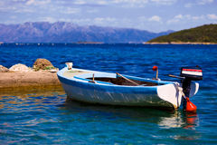 Lonely fishing boat Stock Photos
