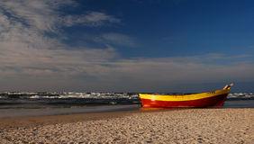 Lonely fishing boat on Baltic sea seaside. Baltic seaside with fishing boat Royalty Free Stock Photography