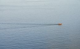 Lonely Fishing Boat In The Ocean Royalty Free Stock Images