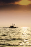Lonely fishing boat. A wonderful moment captured in the camera Stock Photography