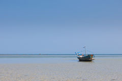 Lonely fishing boats on clear water.  Stock Image
