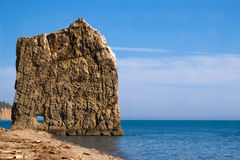 Lonely flat rock. In the sea Stock Photography