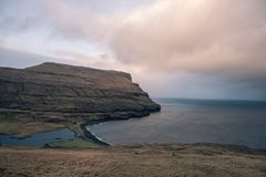 A lonely football field in the faroe islands. This picture shows a lonely football field in the faroe islands Stock Photo