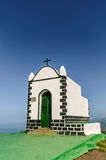 Lonely and forsaken stands this little chapel on the top of the volcanic cone, Montaña de los Frailes. Stock Photo
