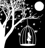 Lonely girl. Black and white fantasy: a tree, the moon and a girl in a cage Stock Photography