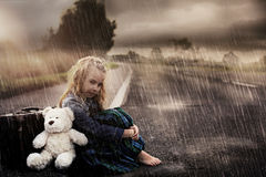 Lonely girl alone on the street. On a rainy day Royalty Free Stock Photo