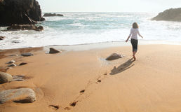 Lonely girl at the beach. Lonely girl at the ocean coast Stock Photography