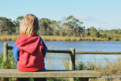 Lonely girl on bench Royalty Free Stock Photo