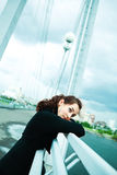 Lonely girl on the bridge Royalty Free Stock Photos
