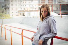 Lonely girl in the city Stock Images