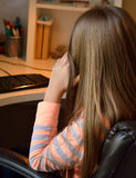 Lonely girl at the computer. Royalty Free Stock Photo